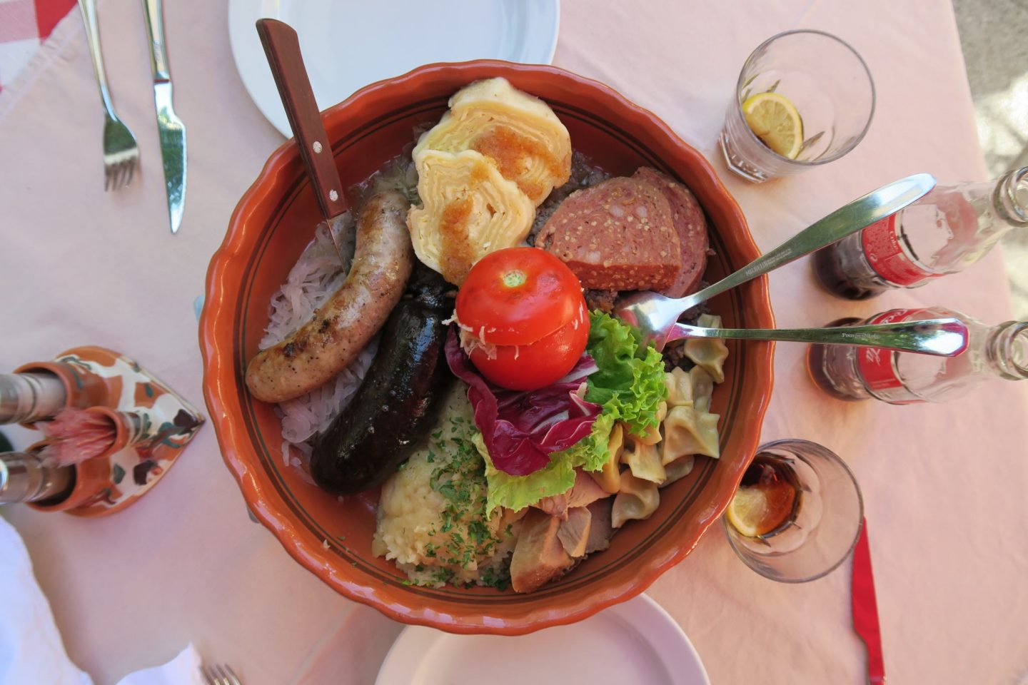 A large bowl full of traditional Slovenian food.