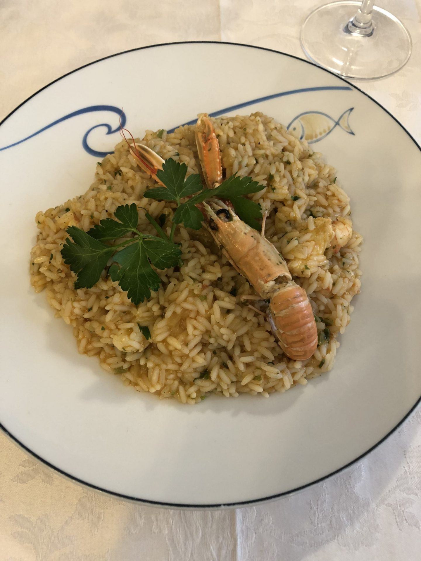Risotto served with a whole unshelled shrimp