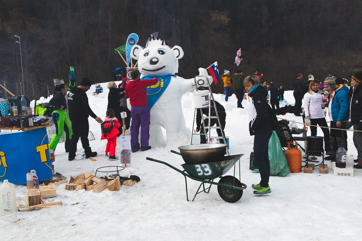 people building a snow bear
