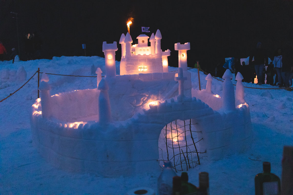 snow castle lit up with candles
